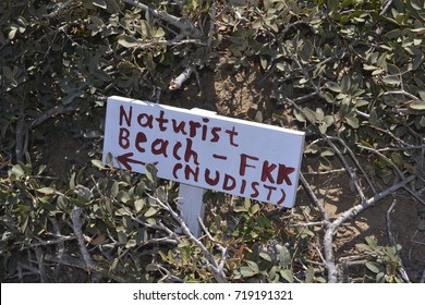 Nudist beach direction sign at Crete, Greece
