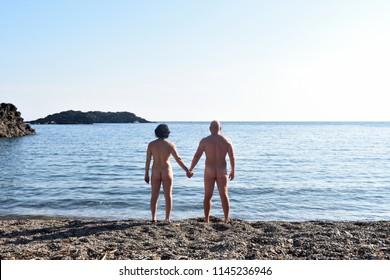 a nudist couple on the beach
