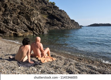 Nudist couple on a beach