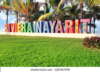 Nuevo Vallarta, Nayarit/ Mexico - 01/09/2019   Colorfully painted Riviera Nayarit sign on a public beach in Mexico. Translation: Coastline Nayarit. This coastline stretches between the historic port o