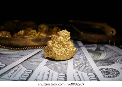 nugget gold and dollar bills, business concept