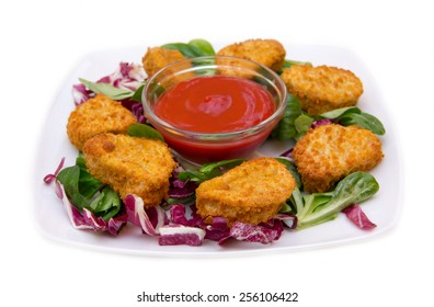 Nuggets of chicken salad on white background