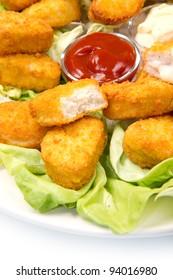 nuggets with ketchup and mayonnaise