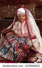 NUKUS, Uzbekistan.October 13, 2010: the model presents the old clothes of an elderly woman from Karakalpakstan in Nukus, Uzbekistan.