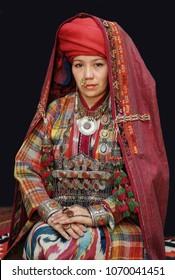 NUKUS, Uzbekistan.October 13, 2010: the model presents the old clothes of a young Karakalpakstan woman in Nukus, Uzbekistan.