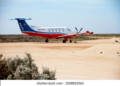 """NULLABOR ROADHOUSE, SOUTH AUSTRALIA, AUSTRALIA-MARCH 21, 2018:The $7 million aircraft,""""Juliet (VH-FXJ), is the first of five medically-equipped Pilatus PC-12 aircraft replacing five ageing aircraft."""