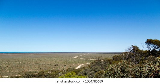 The Nullarbor Plain is part of the area of flat, almost treeless, semi-arid country of southern Australia, located on the Great Australian Bight four times size of Belguim 1256 kilometres to cross it.