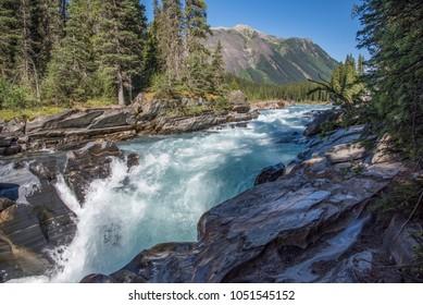 Numa Falls in Kootenay National Park, BC, Canada, under a clear blue sky
