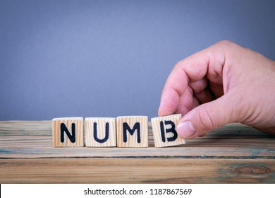 numb. Wooden letters on the office desk, informative and communication background