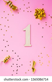 Number 1 celebration on star and glitter pink background