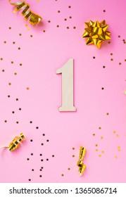 Number 1 celebration on star and glitter pink background