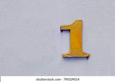 number 1 house number on the wall one