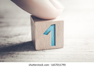 Number 1 On A Wooden Block On A Table