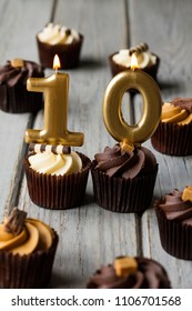 Number 10 celebration birthday cupcakes on a wooden background