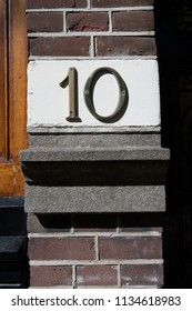 Number 10 house sign in Amsterdam, Netherlands