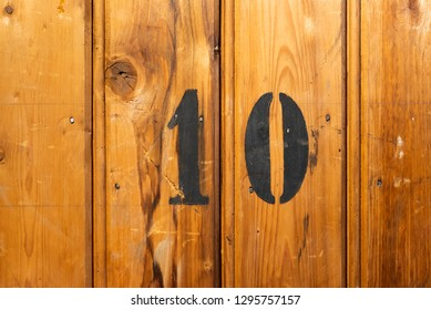 number 10 on door of storage room for tenants in century-old apartment building in stockholm
