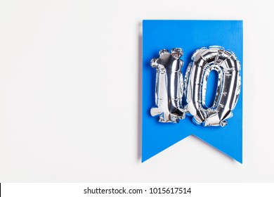 Number 10 silver balloon celebration number on a blue banner