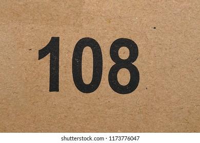 number 108, printed on cardboard
