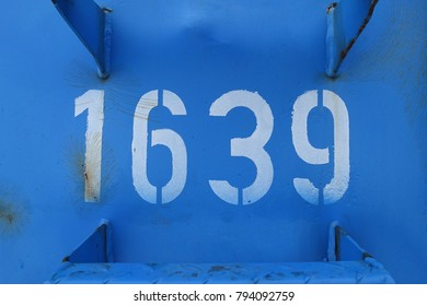 number 1639, white stencil numbers on blue metal background