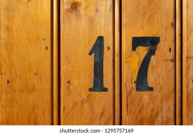 number 17 on door of storage room for tenants in century-old apartment building in stockholm