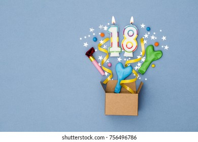 Number 18 celebration present background. Gift box exploding with party decorations