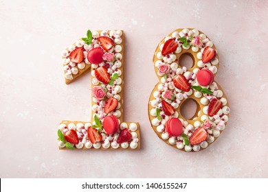Number 18 naked honey cake for Birthday, pink background, top view