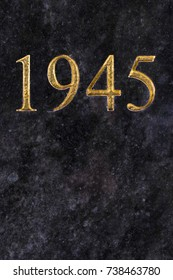 The number 1945, engraved in gold letters on marble.