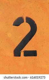 number 2  ,  black stencil letter on orange background
