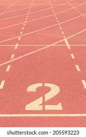 number 2 on running track vintage background