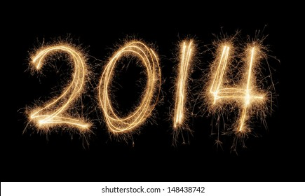 Number 2014 written with a sparkler.