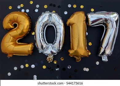 Number 2017 from orange balloons on a black background. holidays and education.