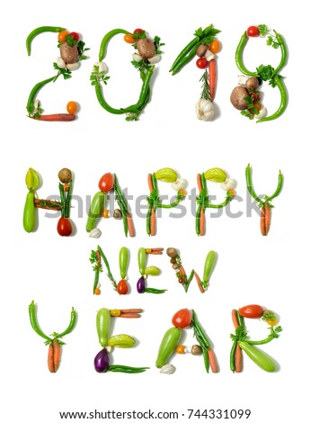 number 2018 and text happy new year written with vegetables as a metaphor or concept