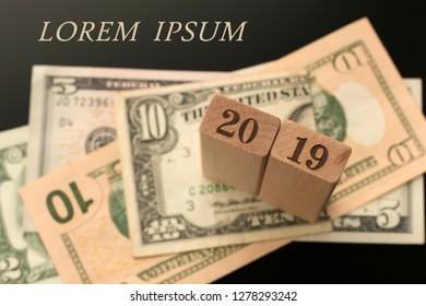 Number 2019 on the dollar banknotes background, Lorem ipsum words.