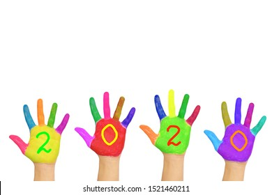 The number 2020 written on the brightly painted hands. New Year and holiday concept. Colorful palms, people are celebrating holidays. Isolated on a white background.