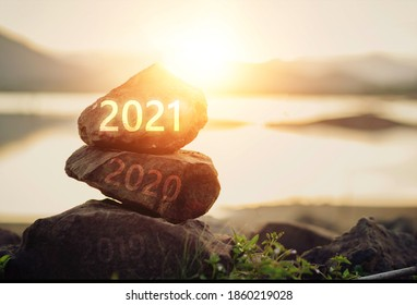 Number 2021 on stone the beach at sunrise. Concept Happy new year.	 - Shutterstock ID 1860219028