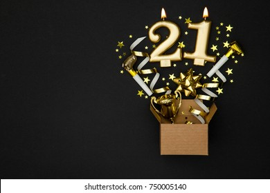 Number 21 gold celebration candle and gift box background