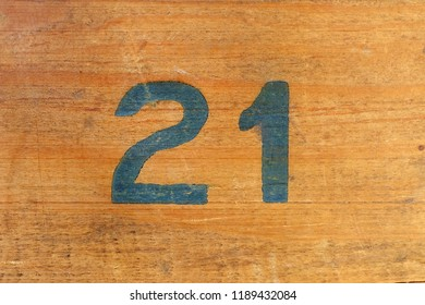number 21, twenty one, printed on wooden background