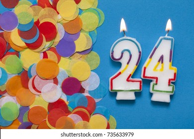 Number 24 celebration candle with party confetti