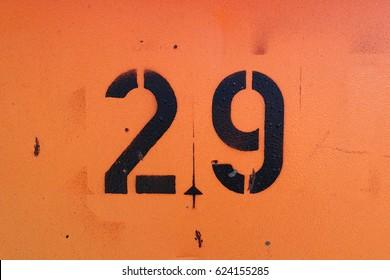 number 29 ,  black spray paint on grunge, orange background