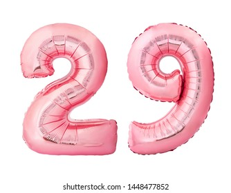 Number 29 twenty nine made of rose gold inflatable balloons isolated on white background. Pink helium balloons forming 29 twenty nine number