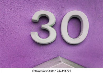 number 30 House number on the wall thirty (30)