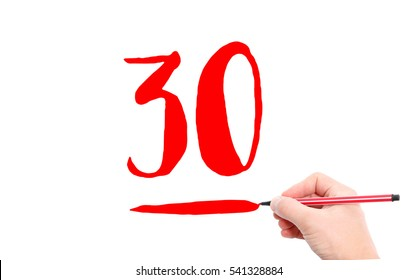 The number 30 written by a hand on a white background