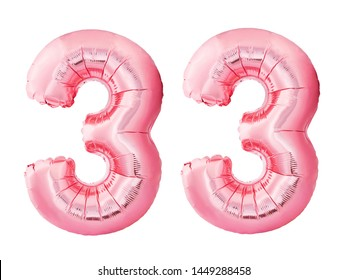 Number 33 thirty three made of rose gold inflatable balloons isolated on white background. Pink helium balloons forming 33 thirty three. Birthday concept