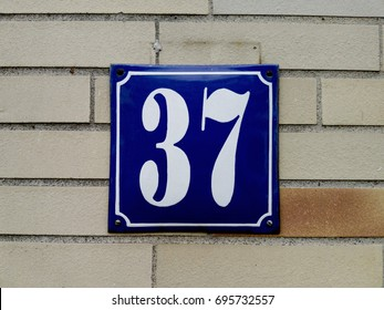 number 37 House numbers on the wall thirty seven (37)