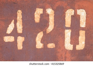 the number 4 2 0 on the metal wall (four hundred and twenty)