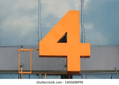 Number 4 figure on facade of modern building