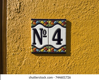 number 4 House number on the wall four (4)
