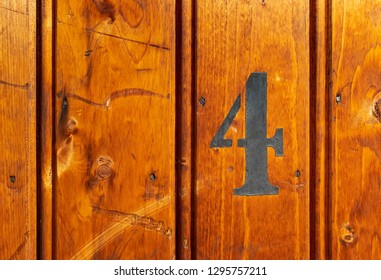 number 4 on door of storage room for tenants in century-old apartment building in stockholm