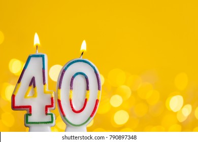 Number 40 Birthday Celebration Candle Against A Bright Lights And Yellow Background