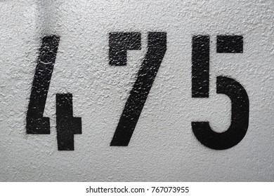 number 475, black on grey background